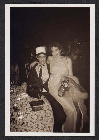 Colin de Land with an unidentified woman at a party