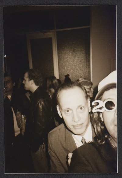 John Waters and Colin de Land at a party