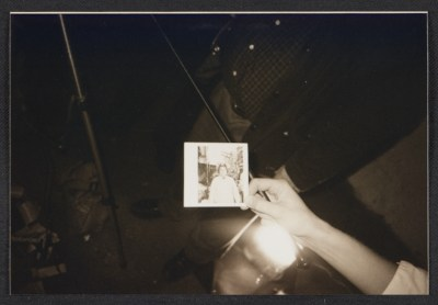 Snapshot of a hand holding up a Polaroid