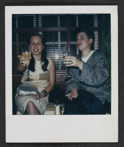 Pat Hearn and an unidentified woman toasting at a party