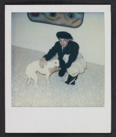 Unidentified man with a dog