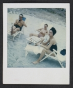 Three unidentified people at the beach