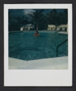 Unidentified man swimming in a hotel pool