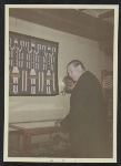 Rene dHarnoncourt in front of a vitrine