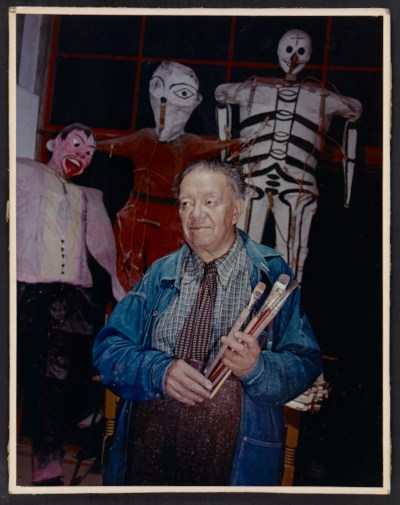 Portrait of Diego Rivera holding paintbrushes