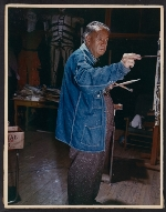 Diego Rivera painting in his studio