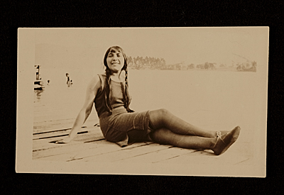[Edith Halpert reclining on a dock]
