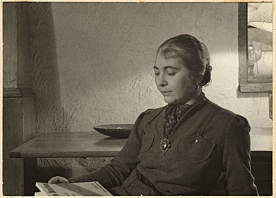 Edith Halpert reading at the home of Charles Sheeler