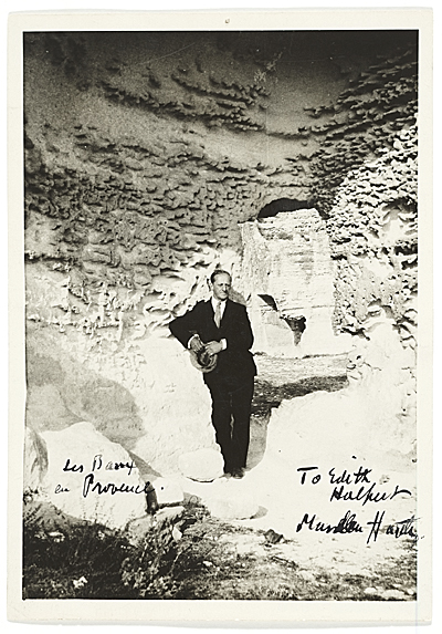 [Marsden Hartley outside a cave in Les Baux, Provence, France.]