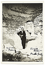 Marsden Hartley outside a cave in Les Baux, Provence, France.