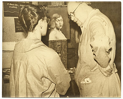 Frank DuMond discussing a painting with a student