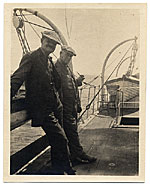 Frank DuMond and Leroy Metcalf on a fishing boat
