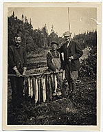 Frank DuMond and guides holding fish