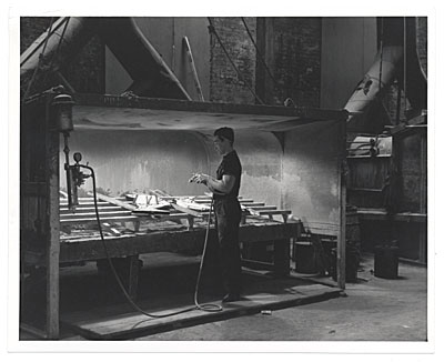 Unidentified man working on tile pieces of J. Scott Williams mural for the Worlds Fair