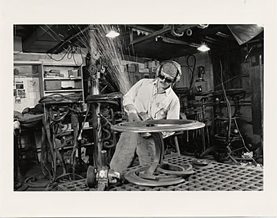 [Albert Paley at work on an end table]