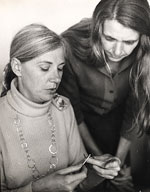 Arline M. Fisch teaching a student to crochet wire
