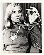 Arline M. Fisch holding a necklace