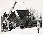 Ronald Bladen watching the installation of his sculpture Black Triangle