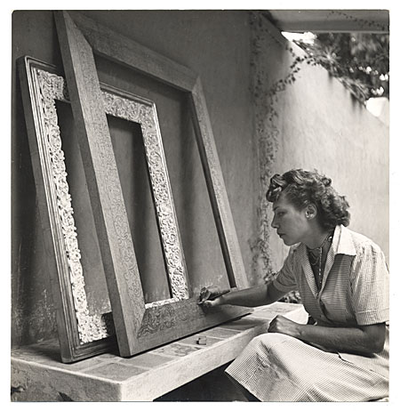 [Grace Bailey laying out a woodcarving]