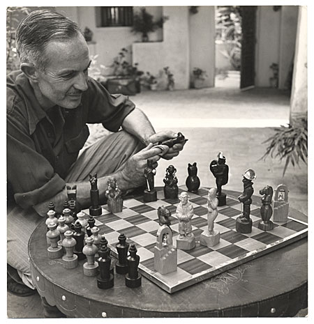[Truman Bailey polishes chess men.]