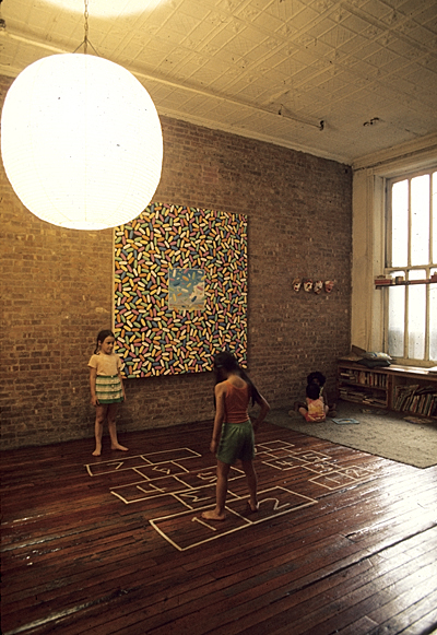 Children playing hopscotch indoors