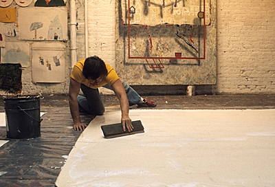 Artist preparing a canvas in a Soho studio
