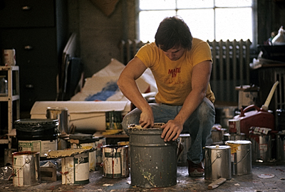 [Artist mixing paint in a Soho studio]