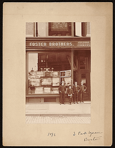 [John Foster and employees in front of the Foster Brothers Picture Framers Store]