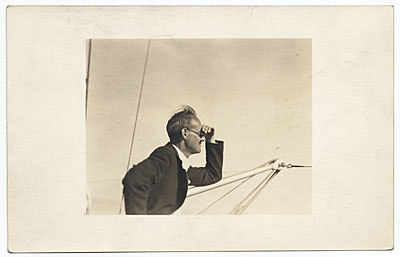 John R. Frazier on the bow of a boat