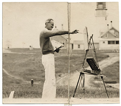 John R. Frazier painting near a lighthouse