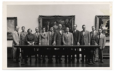 John R. Frazier and group in a gallery