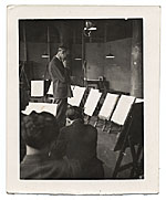 [John R. Frazier reviewing paintings ]
