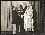 Wood Gaylor and Robert Ament in wedding attire, performing the wedding ceremony for the Penguin Clubs strawberry festival