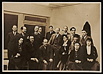 [Hugo Gellert and a group of men and women in business attire ]