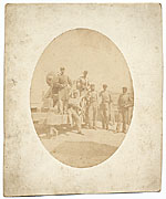 Sanford R. Gifford and others posed near a cannon.
