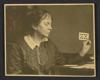 [Anne Goldthwaite playing solitaire]