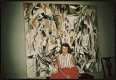 [Joan Mitchell with her painting Untitled (1951) in her parents' apartment in Chicago]
