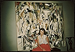 [Joan Mitchell with her painting Untitled (1951) in her parents' apartment in Chicago ]