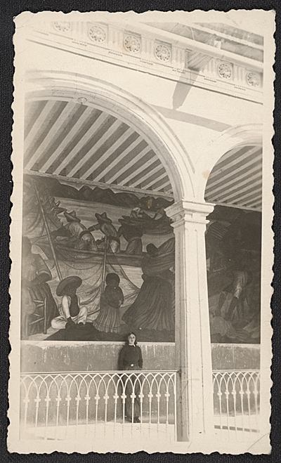 [Marion Greenwood in front of a mural in Mexico]