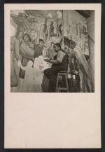 Diego Rivera working on the Nightmare of War, Dream of Peace fresco