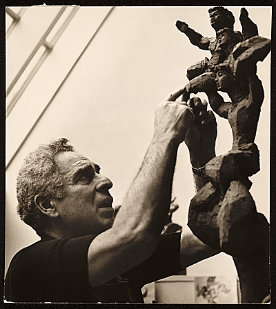 Chaim Gross working on one of his Acrobat sculptures