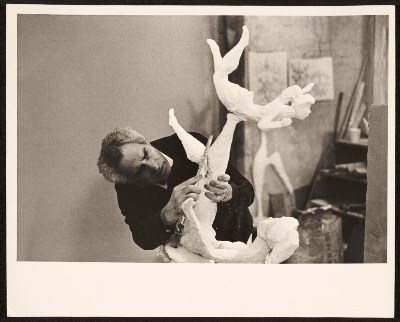 [Chaim Gross working on his sculpture Baby balancing]