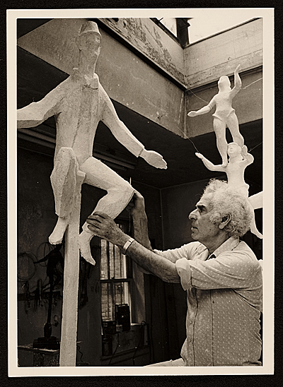[Chaim Gross working on his sculpture Unicyclist]