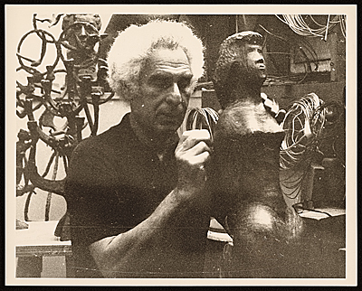 Chaim Gross working on a sculpture in his studio