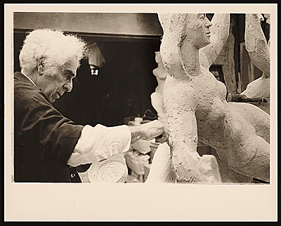 [Chaim Gross working on his sculpture Family at play]