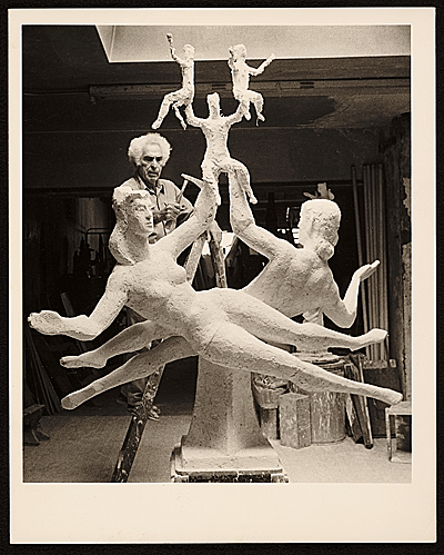 [Chaim Gross working on his sculpture Family at play, front view]