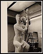 Chaim Gross working on his sculpture Mother and Child