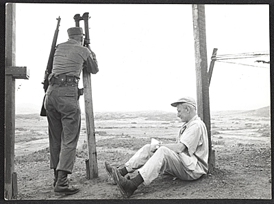 [John Groth sketching at the Korean truce line]