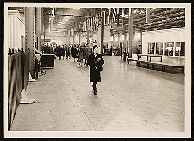Agnes Hart walking in a bus station