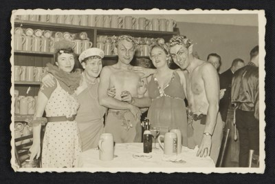 Five people in costume at a Munich beer house